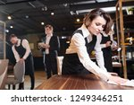 serious busy young waitress and ... | Shutterstock . vector #1249346251