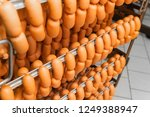 smoked sausages hanging on a... | Shutterstock . vector #1249388947