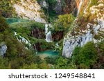 Scenic view from high on Veliki Slap and other waterfalls, rocks and woods of Plitvice Lakes national park in Croatia
