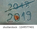 the inscription 2019 and 2018... | Shutterstock . vector #1249577401