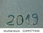 2019 inscription on the glass... | Shutterstock . vector #1249577434