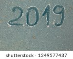 2019 inscription on the glass... | Shutterstock . vector #1249577437