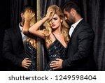 sexy elegant couple. beautiful... | Shutterstock . vector #1249598404