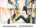 beautiful female choosing novel ... | Shutterstock . vector #1249605007