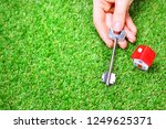 female hand holds a key from... | Shutterstock . vector #1249625371