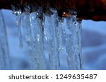 thick icicles hanging from the... | Shutterstock . vector #1249635487