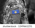 Flag of Kosovo on soldiers arm (collage).