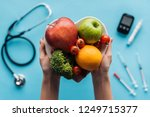 fruits and vegetables in female ... | Shutterstock . vector #1249715377