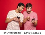 two cheerful young men standing ... | Shutterstock . vector #1249733611