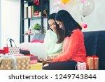 asian christmas friends doing...   Shutterstock . vector #1249743844