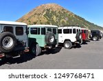 4x4 cars parked in a row and... | Shutterstock . vector #1249768471