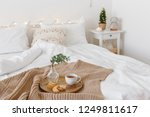 bed with beige knitted blanket  ... | Shutterstock . vector #1249811617