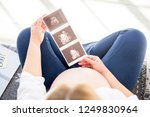 pregnant woman holding... | Shutterstock . vector #1249830964