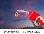 fuel nozzle hand holding red...   Shutterstock . vector #1249852327