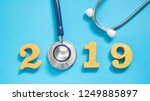 stethoscope w  2019 gold wooden ... | Shutterstock . vector #1249885897