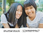 toothy smiling face of asian... | Shutterstock . vector #1249899967