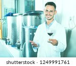 smiling male young winemaker in ...   Shutterstock . vector #1249991761