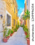 the narrow street in old town... | Shutterstock . vector #1249996354