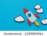 top view of cardboard rocket...   Shutterstock . vector #1250004961