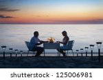 a young couple share a romantic ... | Shutterstock . vector #125006981