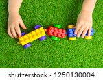 artificial turf. baby plays... | Shutterstock . vector #1250130004