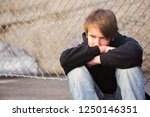 a sorrowful kid on the city... | Shutterstock . vector #1250146351