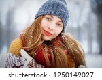 winter young woman portrait.... | Shutterstock . vector #1250149027