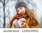 winter young woman portrait.... | Shutterstock . vector #1250149051