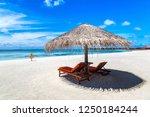 wooden sunbed and umbrella on...   Shutterstock . vector #1250184244