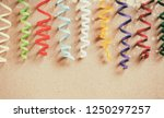 colorful paper streamers.... | Shutterstock . vector #1250297257