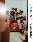 family using technology... | Shutterstock . vector #1250300971