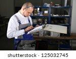 mechanical technician at work | Shutterstock . vector #125032745