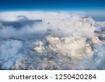 aerial view of clouds and earth ... | Shutterstock . vector #1250420284