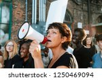 Feminist With A Megaphone At A...
