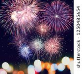 fireworks with silhouettes... | Shutterstock . vector #1250485654