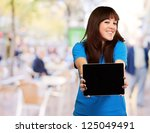 woman holding tablet  outdoor | Shutterstock . vector #125049491