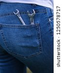 wrenches in the back pocket of... | Shutterstock . vector #1250578717