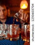 bartender prepares a  cocktail ... | Shutterstock . vector #1250603704