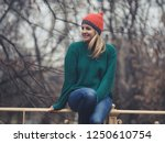 happy woman at wintertime.  | Shutterstock . vector #1250610754