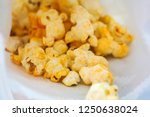 cheese flavour popcorn | Shutterstock . vector #1250638024