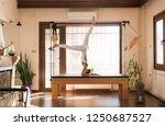 peak pilates   young woman... | Shutterstock . vector #1250687527