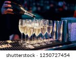 Pouring champagne into flute glasses