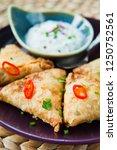 indian spicy vegetable samosa... | Shutterstock . vector #1250752561