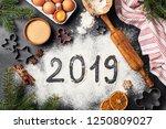 new year 2019 written on flour. ... | Shutterstock . vector #1250809027