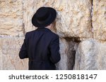 praying at the wall in jerusalem | Shutterstock . vector #1250818147