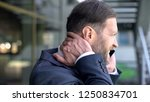 middle aged man suffering neck...   Shutterstock . vector #1250834701