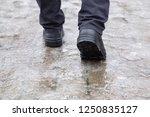 young man's legs in black... | Shutterstock . vector #1250835127