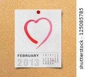 Calendar 2013 and red heart on note paper background. - stock photo