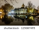 Stock photo swiss national museum schweizerisches landesmuseum in zurich at night switzerland 125087495