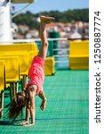 girl doing cartwheels on...   Shutterstock . vector #1250887774